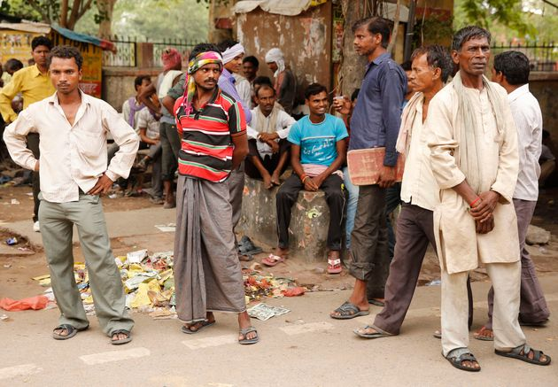 Daily wage laborers wait to get employed for the