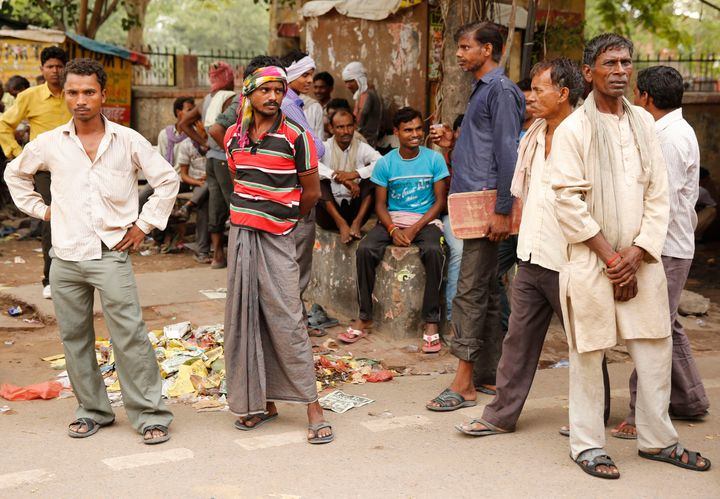 Daily wage laborers wait to get employed for the day.