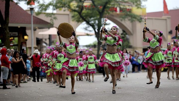Dancers from a Hmong language and culture school perform at the 2018 Minnesota State Fair. Like other states, Minnesota is ta