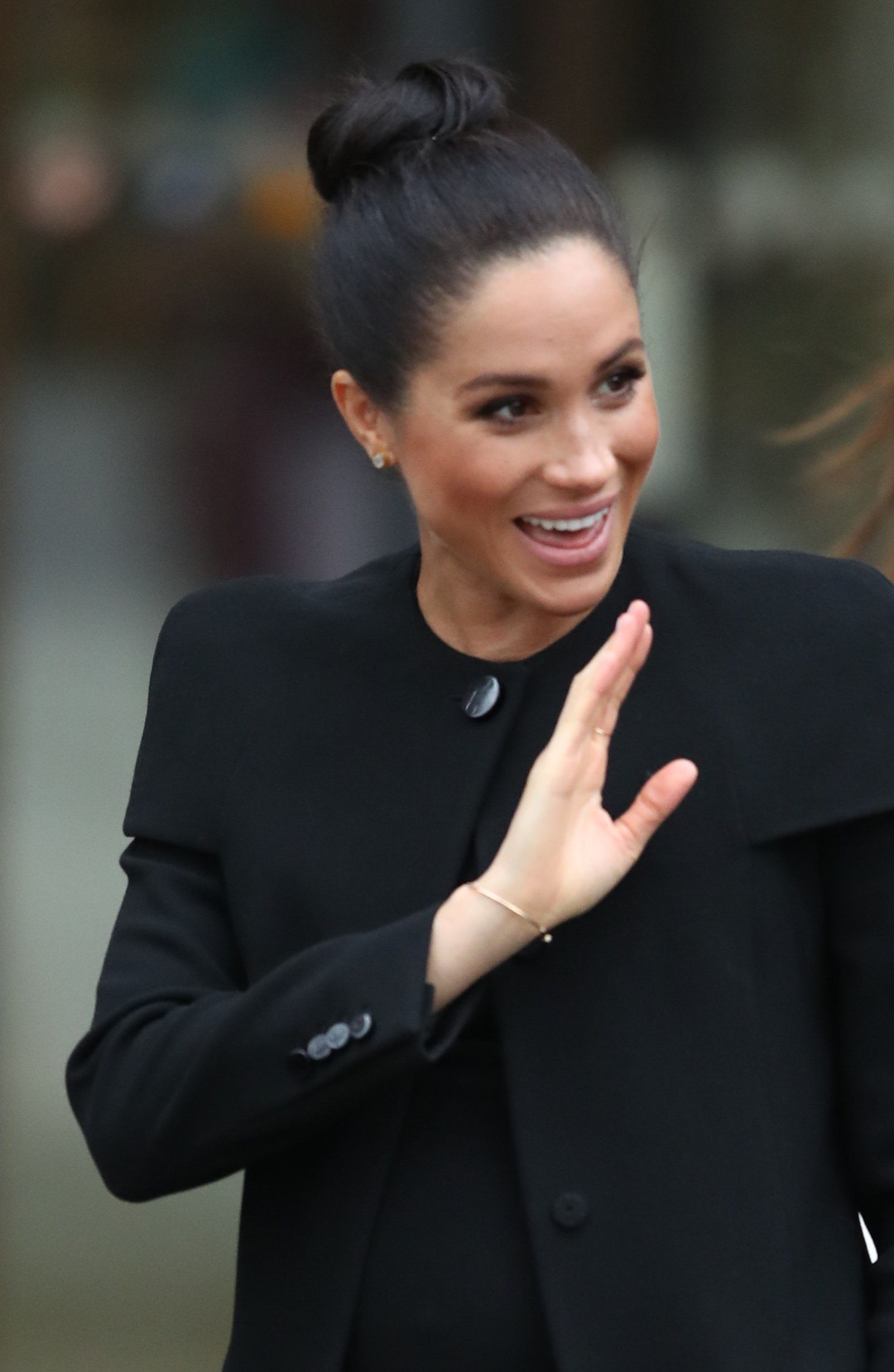 The Duchess of Sussex waves as she leaves after a visit to the Association of Commonwealth Universities at the University of London. (Photo by Andrew Matthews/PA Images via Getty Images)