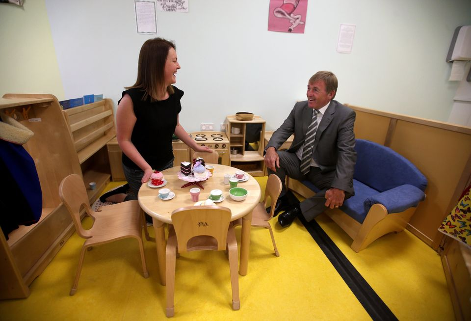 Former Scottish footballer Kenny Dalglish tries out a sofa in the children's nursery after officially...