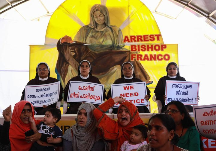 Christian nuns and Muslim supporters protest as they demand the arrest of Bishop Franco Mulakkal outside the High Court in Ko