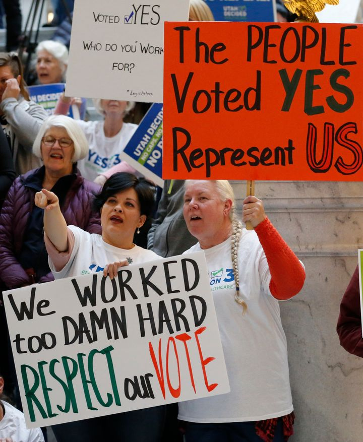 Tiffiny Malo, left, and Pam Harrison, supporters of a voter-approved measure to fully expand Medicaid, at a rally to ask lawm