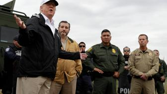 President Donald Trump speaks as tours the U.S. border with Mexico at the Rio Grande on the southern border, Thursday, Jan. 10, 2019, in McAllen, Texas, as Sen. Ted Cruz, R-Texas, listens. (AP Photo/ Evan Vucci)
