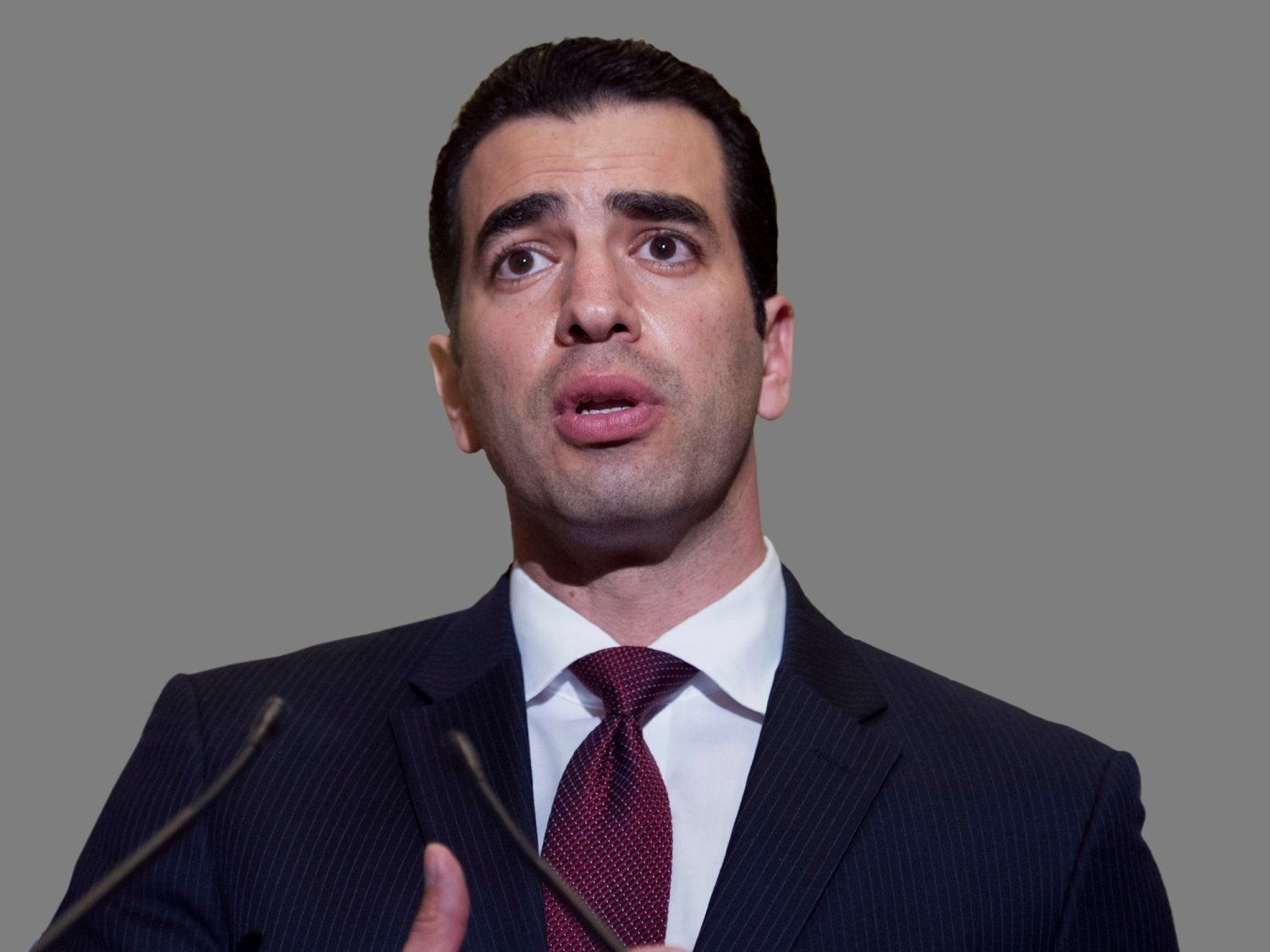 Ruben Kihuen headshot,  US Representative of Nevada, graphic element on gray