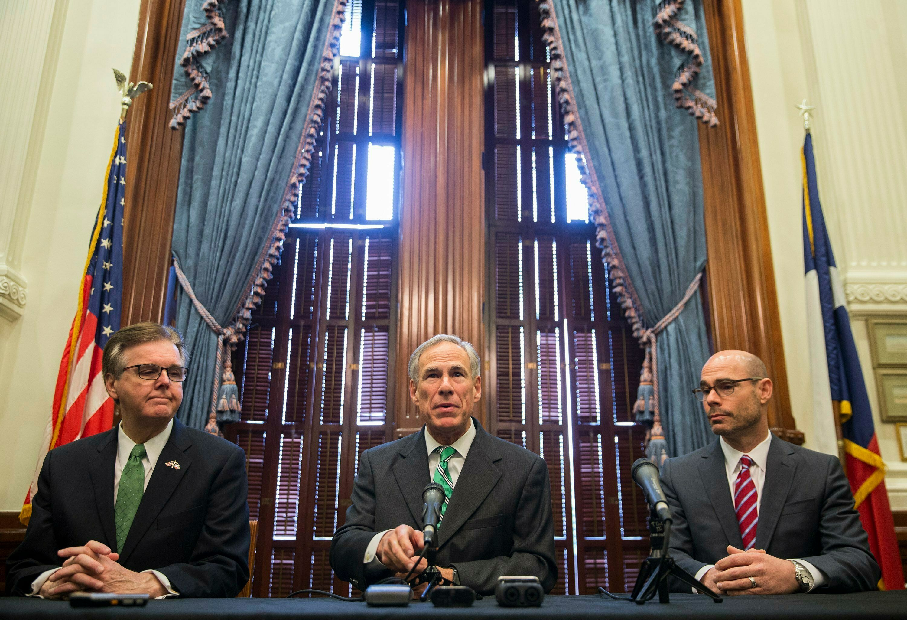 Gov. Greg Abbott, Lt. Gov. Dan Patrick and Speaker Dennis Bonnen as well as chairmen for committees charged with studying property tax reforms spoke to the local news media during a press conference Thursday, Jan. 31, 2019, about tax reform in Texas. (Ricardo B. Brazziell/Austin American-Statesman via AP)