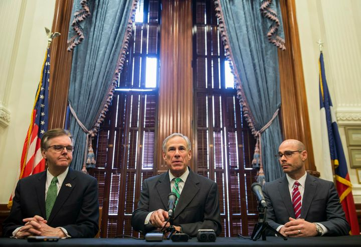 Texas Gov. Greg Abbott, middle, isn't worried about his state's disastrous citizenship probe.