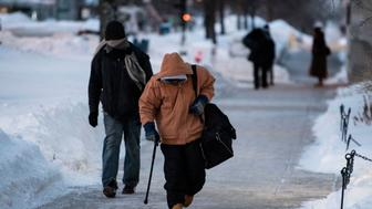 MADISON, WIS.  JAN. 30, 2019: Men walk from one shelter to another in the early morning as temperatures reach -49 with wind chill in Madison, Wis. Jan. 30, 2019. (Photo by Lauren Justice for The Washington Post via Getty Images)