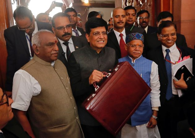 Interim Finance Minister Piyush Goyal holds his briefcase as he arrives at the parliament to present...