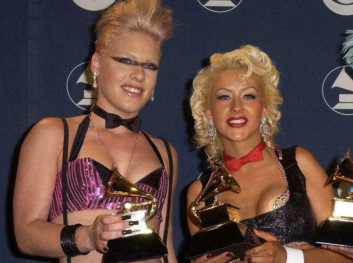 Pink and Christina Aguilera pose together at the 2002 Grammy Awards.