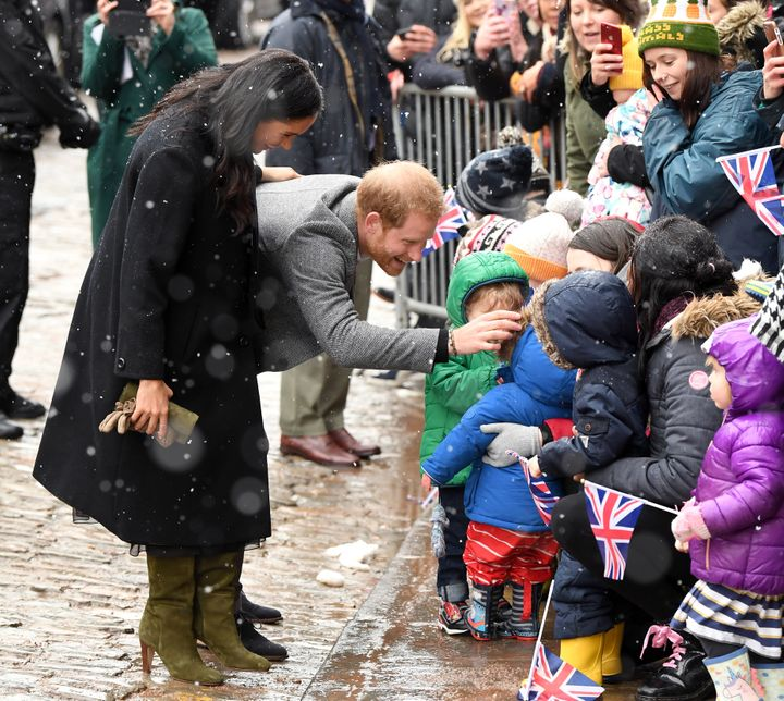 Meghan and Harry chat with a group of schoolchildren.