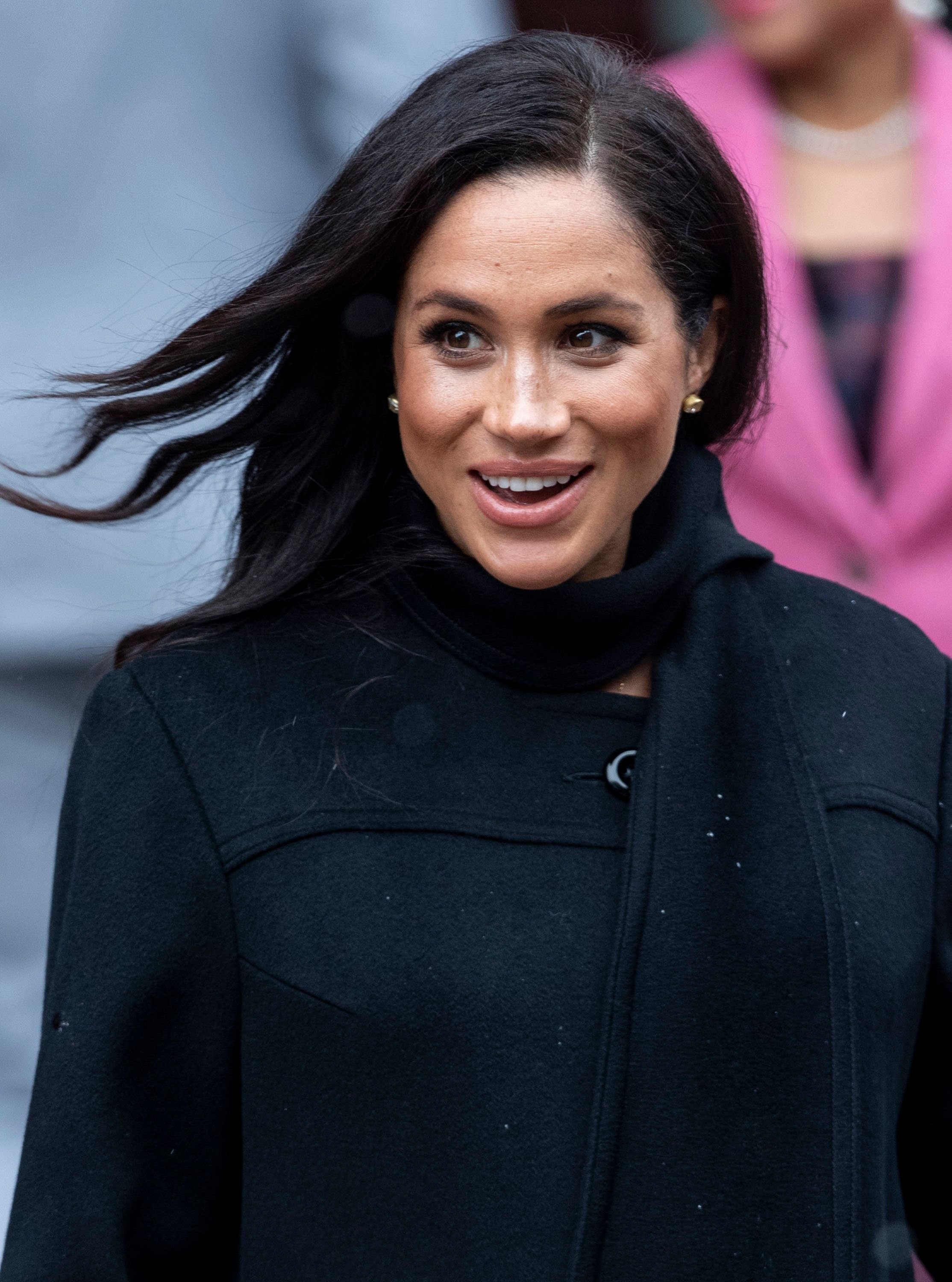 BRISTOL, ENGLAND - FEBRUARY 01: Meghan, Duchess of Sussex visits the Bristol Old Vic and meets members of the public gathered outside on February 1, 2019 in Bristol, England. (Photo by Mark Cuthbert/UK Press via Getty Images)