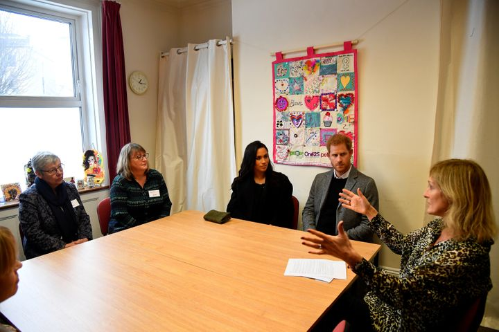 Meghan and Harry meet One25 staffers and volunteers.