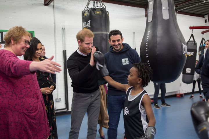 Meghan and Harry meet 7-year-old Aziah Selassie during their visit to Empire Fighting Chance.