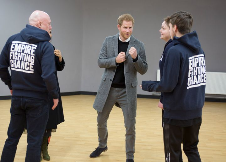 Harry chats with Lestyn Jones and Sarah Lucey during a visit to the boxing charity Empire Fighting Chance in Bristol.