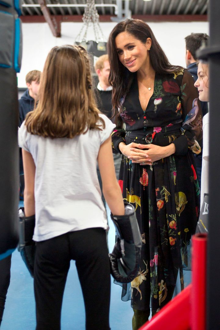 Meghan talks with a young boxer at Empire Fighting Chance, which helps at-risk youths.