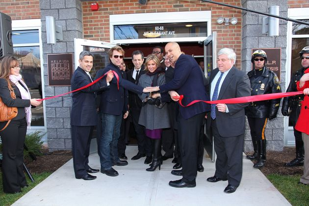 From left, North Ward councilman Anibal Ramos Jr., musician Jon Bon Jovi, designer Kenneth Cole, HELP...