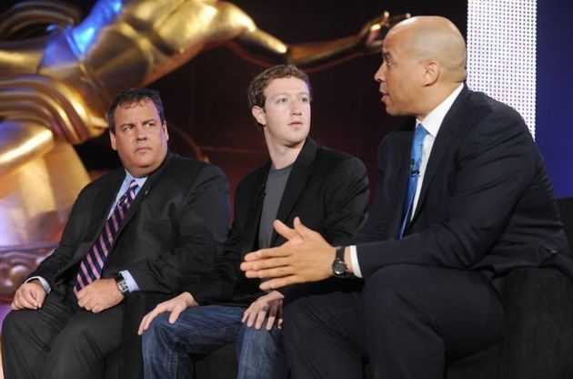 Former New Jersey Gov. Chris Christie, Facebook CEO Mark Zuckerberg and Newark Mayor Cory Booker at an...