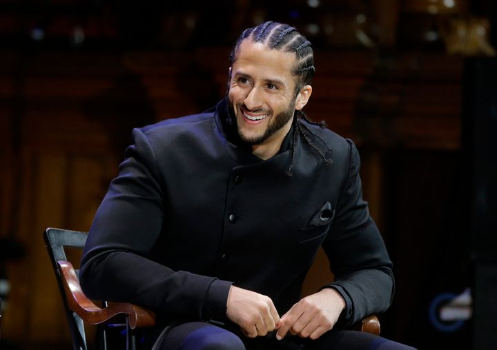 Former NFL football quarterback Colin Kaepernick is seated on stage during W.E.B. Du Bois Medal ceremonie at Harvard Universi