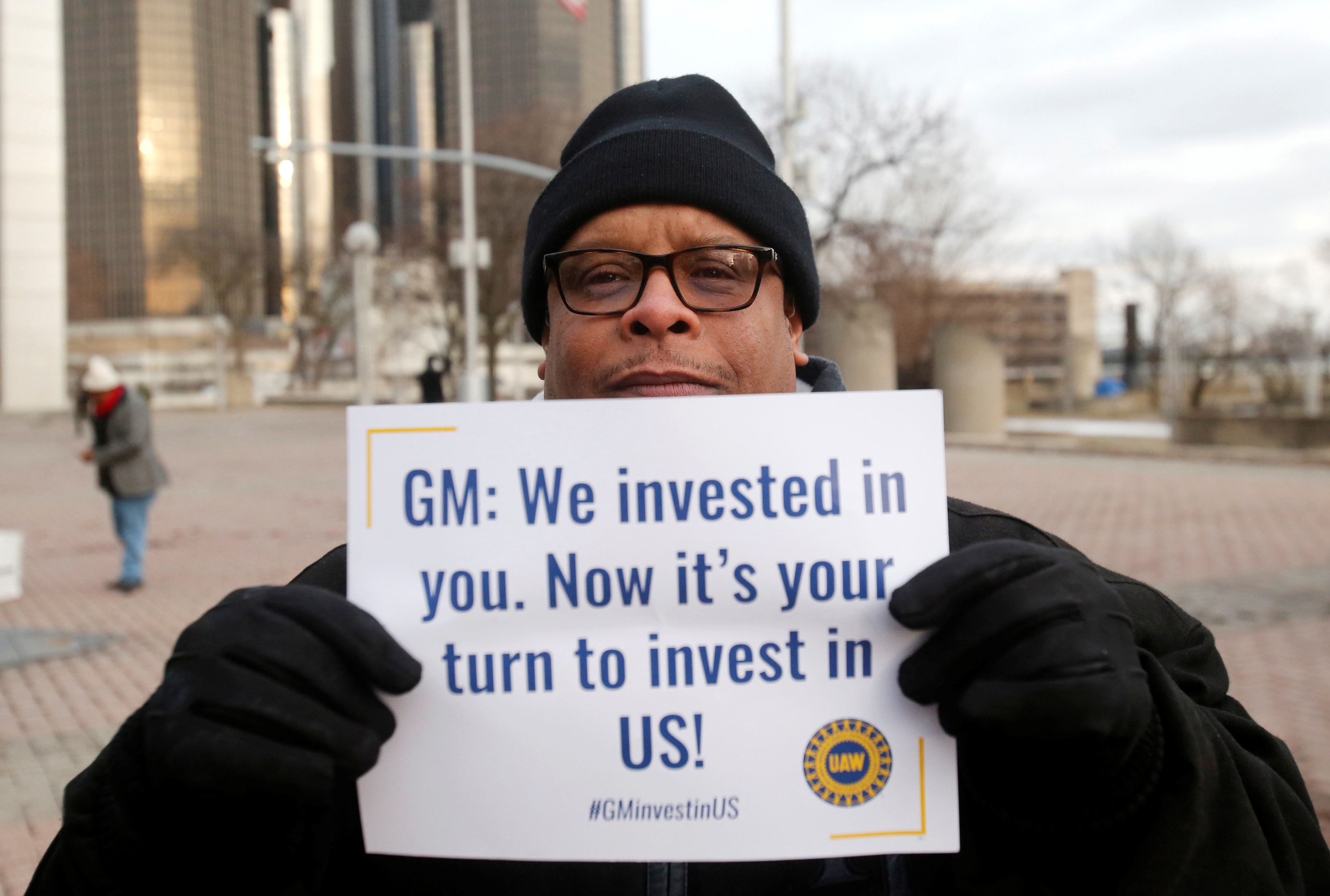 General Motors Detroit/Hamtramck assembly worker Henry Fleming holds his protest sign before the start of a rally to protest GM's planned plant closures in Detroit, Michigan, U.S. January 18, 2019.   REUTERS/Rebecca Cook