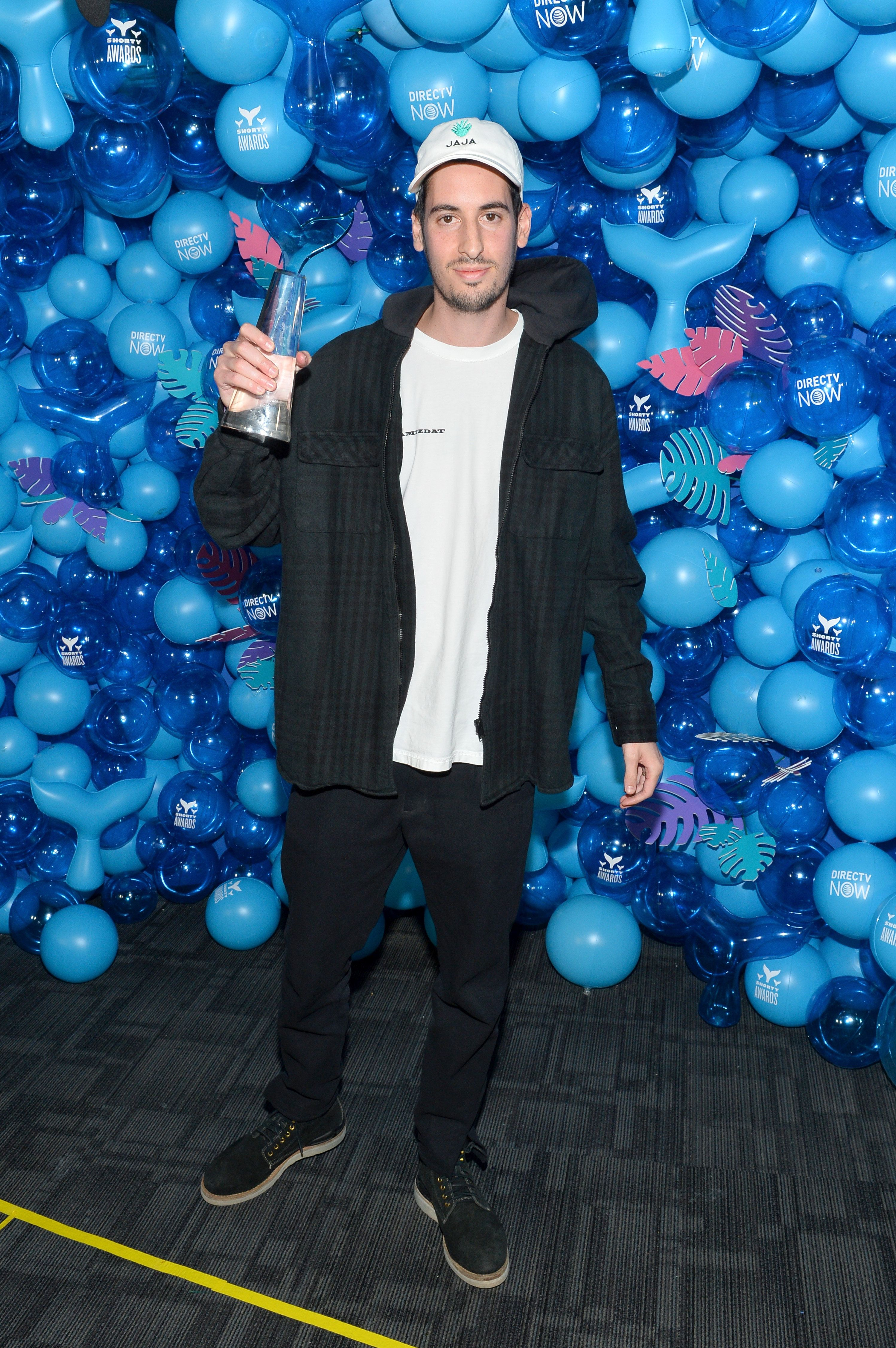 NEW YORK, NY - APRIL 15:  Elliot Tebele poses with the award for Best Meme/Parody Account for fuckjerry during the 10th Annual Shorty Awards at PlayStation Theater on April 15, 2018 in New York City.  (Photo by Noam Galai/Getty Images for Shorty Awards)