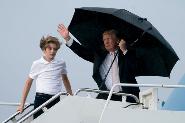 President Donald Trump and his son Barron board Air Force One at Palm Beach International Airport in...