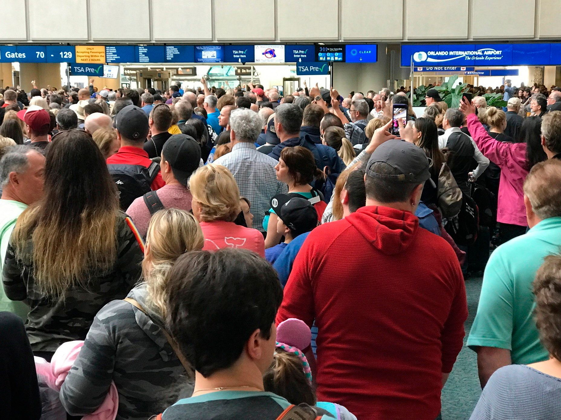 "<p> People wait to get through security at the Orlando International Airport following a security incident on Saturday, Feb. 2, 2019. Passengers on shuttles to gates at Florida's busiest airport had to be brought back for a second screening, bringing security checkpoints to a temporary standstill. A spokeswoman for Orlando International Airport told television station WKMG on Saturday that the passengers were returned in ""an abundance of caution"" after some passengers may have gotten through the checkpoints without being screened property. (Jonathan Hayward/The Canadian Press via AP) </p>"