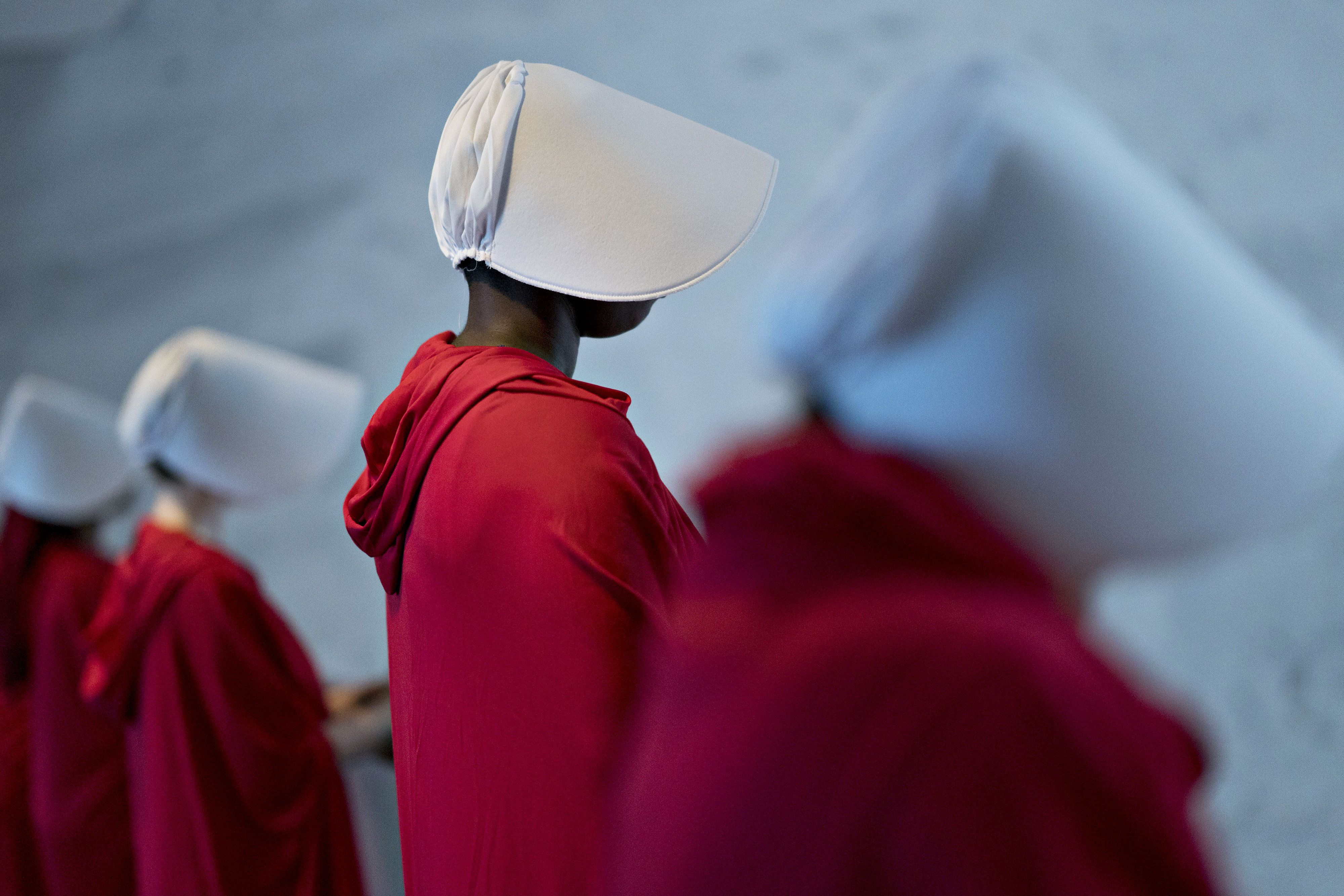 Bloomberg Best of the Year 2018: Demonstrators dressed in 'Handmaid's Tale' costumes stand in the Dirksen Senate Office building before a Senate Judiciary Committee confirmation hearing for Brett Kavanaugh, U.S. Supreme Court associate justice nominee for U.S. President Donald Trump, not pictured, in Washington, D.C., U.S., on Tuesday, Sept. 4, 2018. Photographer: Andrew Harrer/Bloomberg via Getty Images