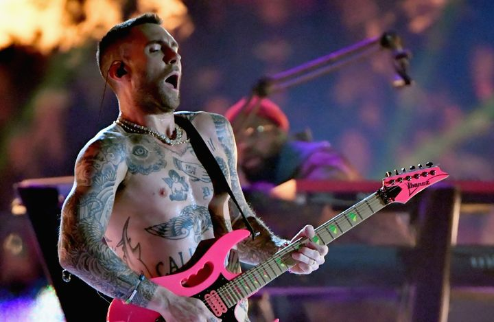 Maroon 5 singer Adam Levine removed his shirt while performing in the Super Bowl halftime show on Sunday.