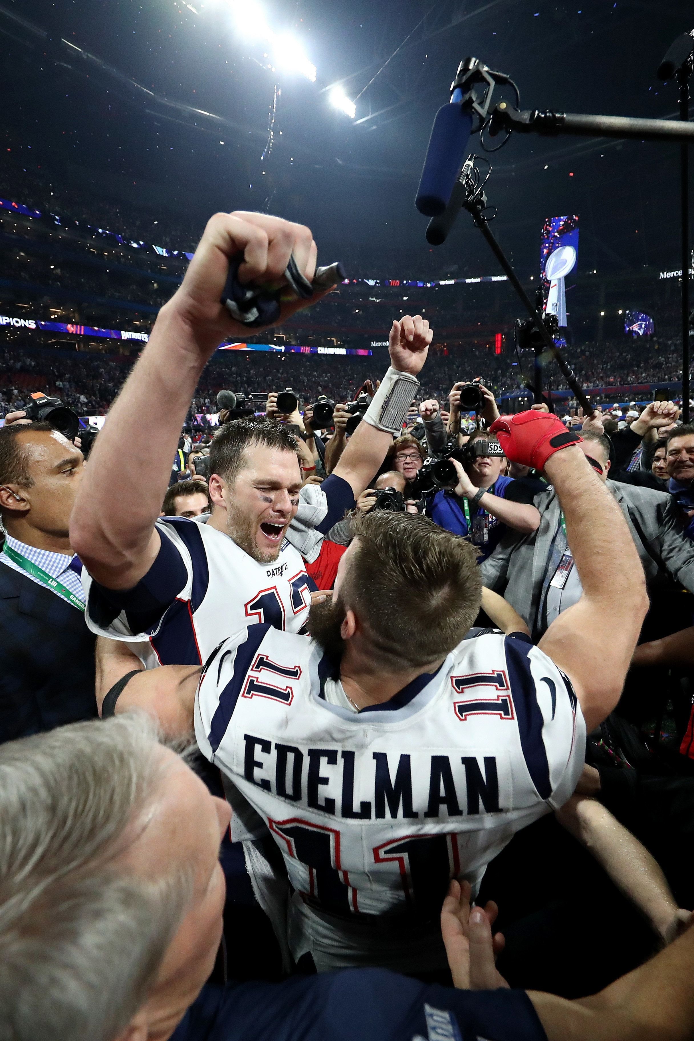 ATLANTA, GEORGIA - FEBRUARY 03:  Tom Brady #12 of the New England Patriots and Julian Edelman #11 celebrate their teams 13-3 win over the Los Angeles Rams during Super Bowl LIII at Mercedes-Benz Stadium on February 03, 2019 in Atlanta, Georgia. (Photo by Al Bello/Getty Images)