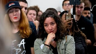 Ana Maria Archila of New York, N.Y., becomes emotional as protesters against Supreme Court nominee Brett Kavanaugh tell their personal stories of sexual assault outside offices of Sen. Jeff Flake, R-Ariz., on Capitol Hill in Washington, Monday, Sept. 24, 2018, as the Senate begins a week of scrutiny of President Donald Trump's nominee to the high court. Judge Brett Kavanaugh's nomination to the U.S. Supreme Court has been further imperiled by a second sexual-misconduct allegation, dating to his first year at Yale University. (AP Photo/Andrew Harnik)