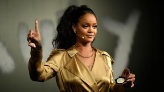 DUBAI, UNITED ARAB EMIRATES - SEPTEMBER 29:  Rihanna gestures on stage during her Fenty Beauty talk in collaboration with Sephora, for the launch of her new Stunna Lip paint 'Uninvited' on September 29, 2018 in Dubai, United Arab Emirates.  (Photo by Mark Ganzon/Getty Images for Fenty Beauty)