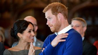 Britain's Prince Harry and his fiancée US actress Meghan Markle watch a dance performance by Jukebox Collective in the banqueting hall during a visit at Cardiff Castle in Cardiff, south Wales on January 18, 2018, for a day showcasing the rich culture and heritage of Wales. / AFP PHOTO / POOL / Ben Birchall        (Photo credit should read BEN BIRCHALL/AFP/Getty Images)