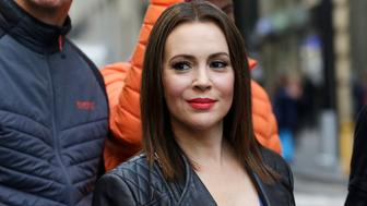 Actress Alyssa Milano attends a news conference where she spoke in favor of the adoption of the Equal Rights Amendment to the Constitution, Monday, June 4, 2018, in New York. Although the ERA passed Congress in 1972, it was ratified by only 35 of the 38 states required to amend the Constitution. (AP Photo/Mark Lennihan)