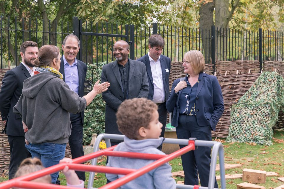 Joe Ejiofor (centre), leader of Haringey Council, at the opening of the Pocket Living Community