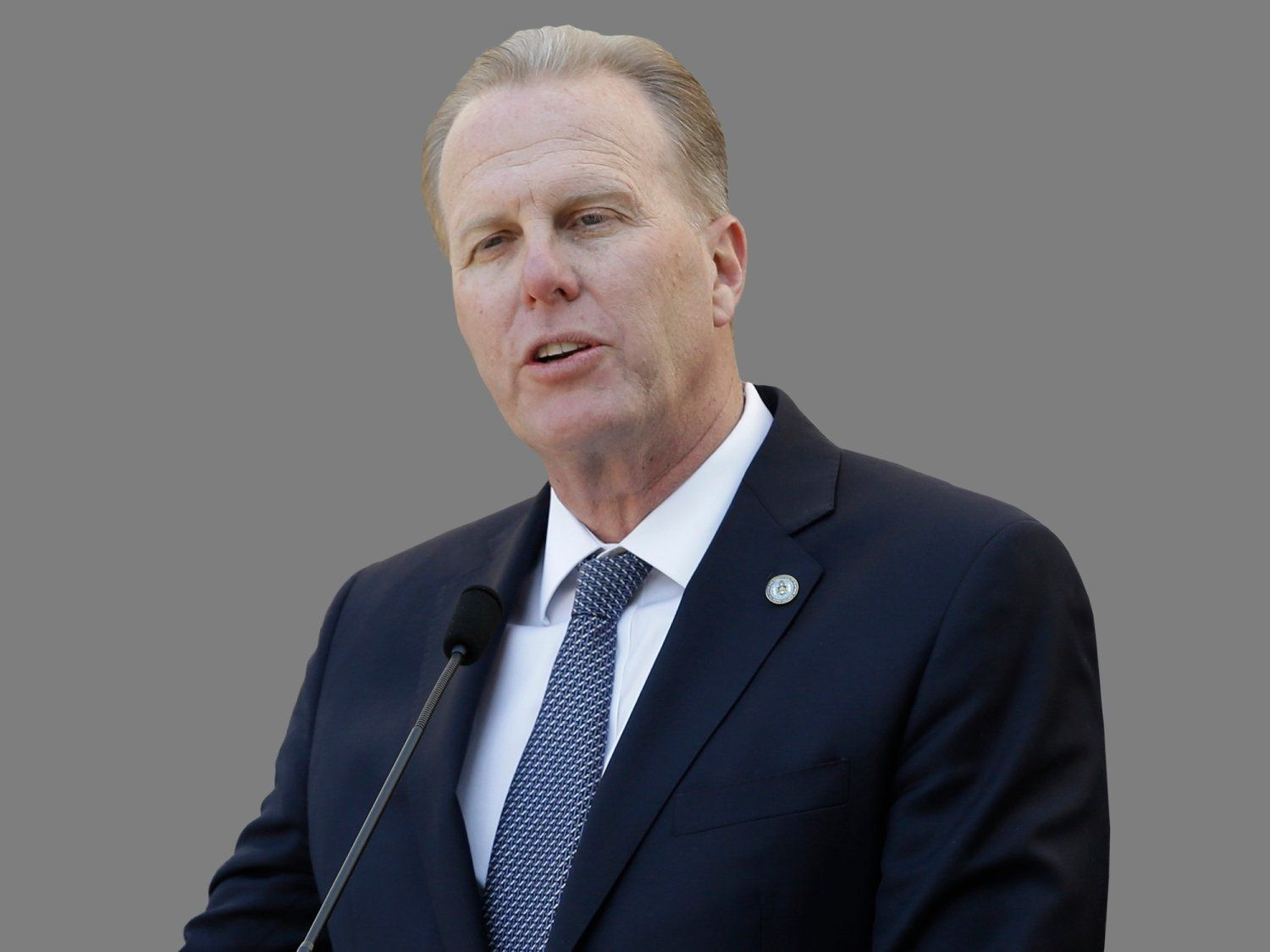Kevin Faulconer headshot, as San Diego mayor, graphic element on gray