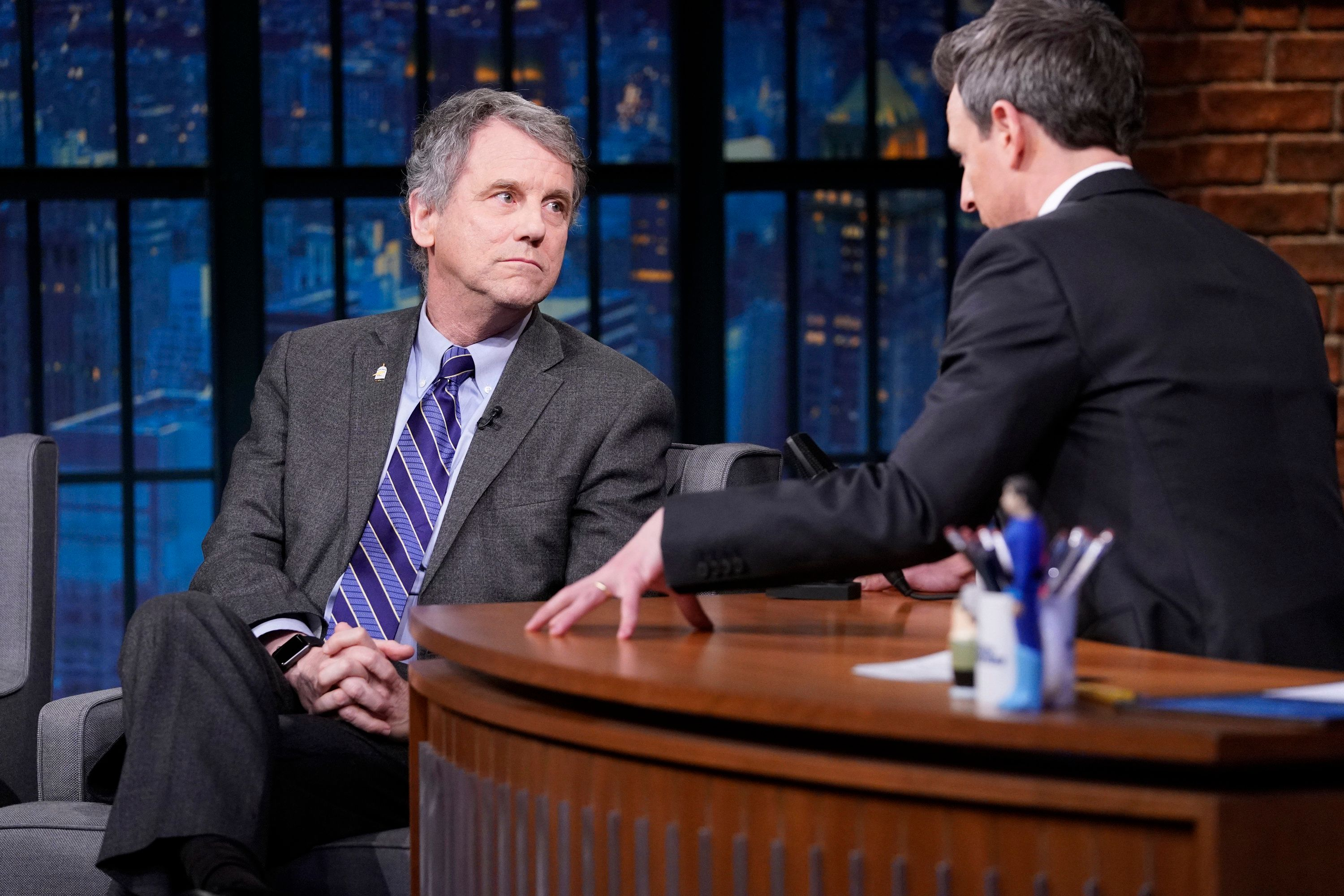 LATE NIGHT WITH SETH MEYERS -- Episode 787 -- Pictured: (l-r) Senator Sherrod Brown during an interview with host Seth Meyers on January 23, 2019 -- (Photo by: Lloyd Bishop/NBC/NBCU Photo Bank via Getty Images)