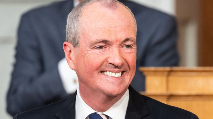 New Jersey Gov. Phil Murphy (D) signed legislation Monday to gradually increase the state's minimum wage to $15 per hou