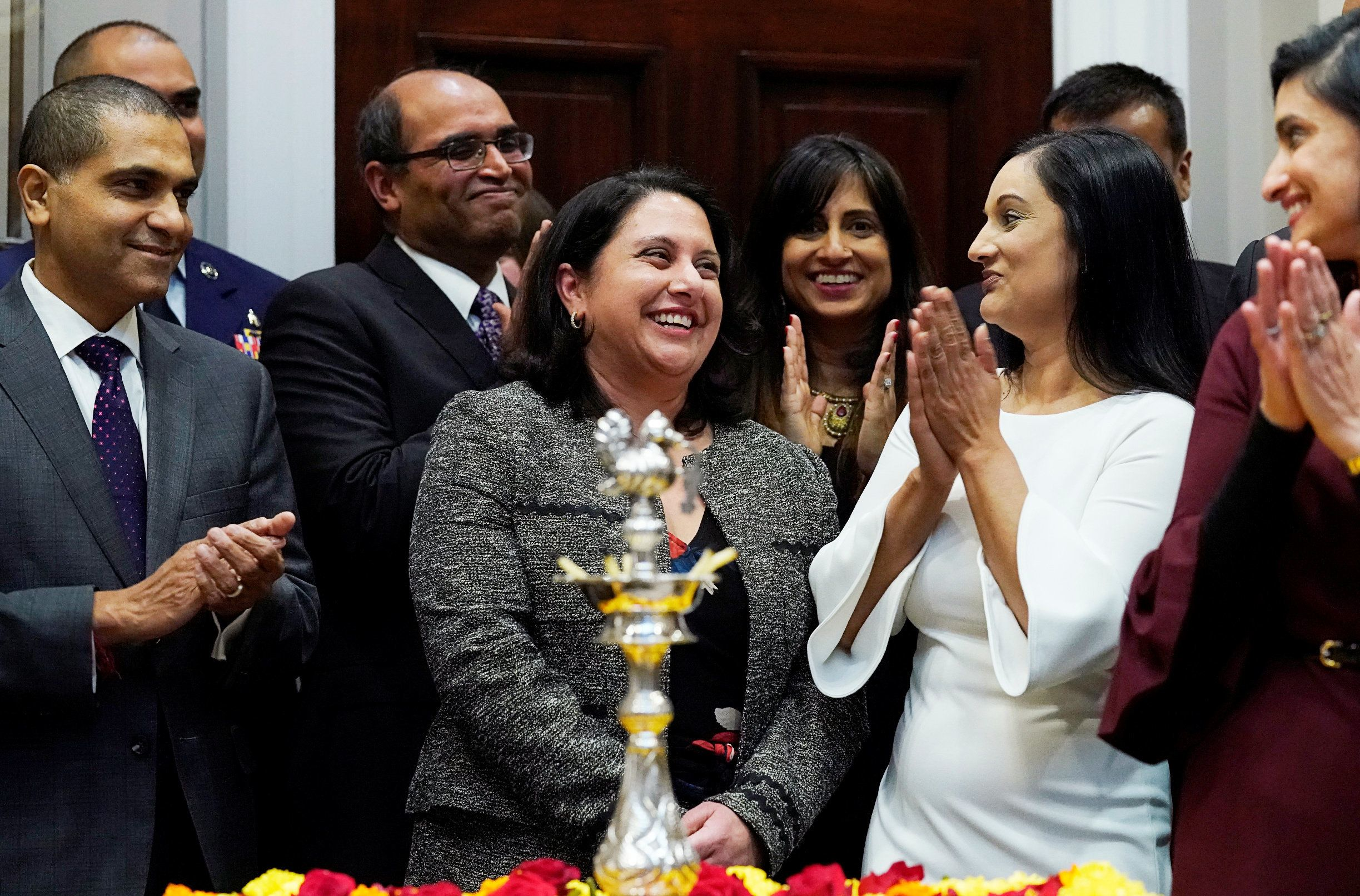 Neomi Rao (C), the administrator of the White House Office of Information and Regulatory Affairs, responds to applause from attendees as U.S. President Donald Trump announces that he is appointing her to replace Supreme Court Justice Brett Kavanaugh on the U.S. D.C. Circuit Court of Appeals during a Diwali ceremonial lighting of the Diya at the White House in Washington, U.S. November 13, 2018. REUTERS/Jonathan Ernst