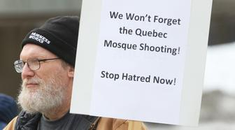 Man holding a sign saying 'We Won't Forget the Quebec Mosque Shooting' during rally held in Toronto, Ontario, Canada, on January 27, 2018. The rally was held to remember those killed in the Quebec City mosque that took place one year ago during a and to condemn Islamophobia, hate, and racism. The rally marked one year since the horrific killing of 6 Muslims at the Islamic Cultural Centre of Quebec. Over the past year, there has been a significant rise of Islamophobia and hate across North America and Europe following the election of Donald Trump and the support of far-right politicians in Europe. (Photo by Creative Touch Imaging Ltd./NurPhoto via Getty Images)