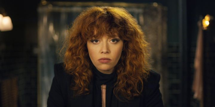 "Nadia (Natasha Lyonne) gazing into her reflection, again, in ""Russian Doll."""