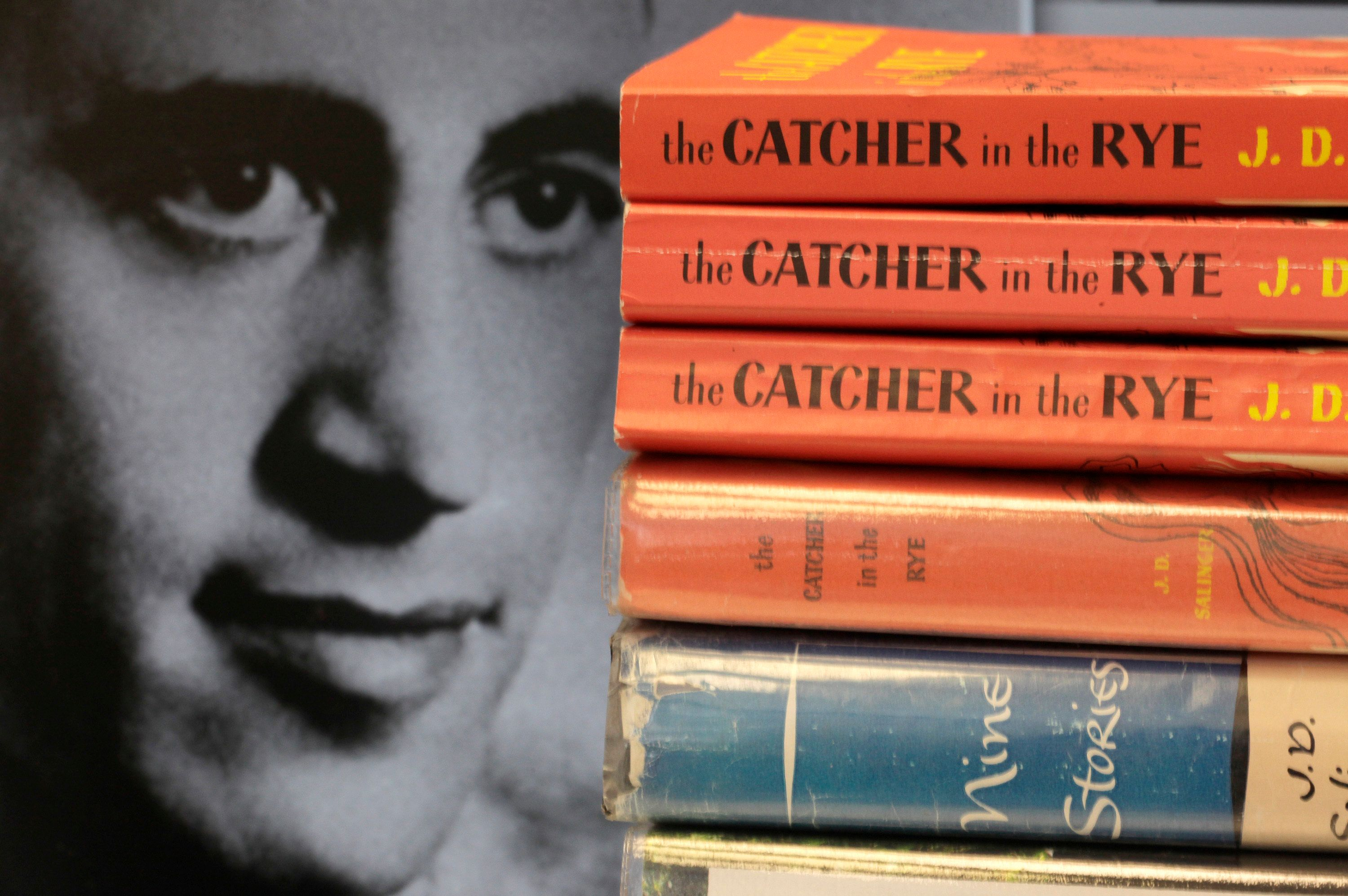 "FILE - This Thursday, Jan. 28, 2010, file photo shows copies of J.D. Salinger's classic novel ""The Catcher in the Rye"" as well as his volume of short stories called ""Nine Stories"" at the Orange Public Library in Orange Village, Ohio. In comments which appeared Friday, Feb. 1, 2019 in The Guardian, Matt Salinger, son of the famous author, confirmed longstanding reports that his father had continued to write long after he stopped publishing books and that he and Salinger's widow are ""going as fast as we freaking can"" to prepare the material for release. (AP Photo/Amy Sancetta, File)"