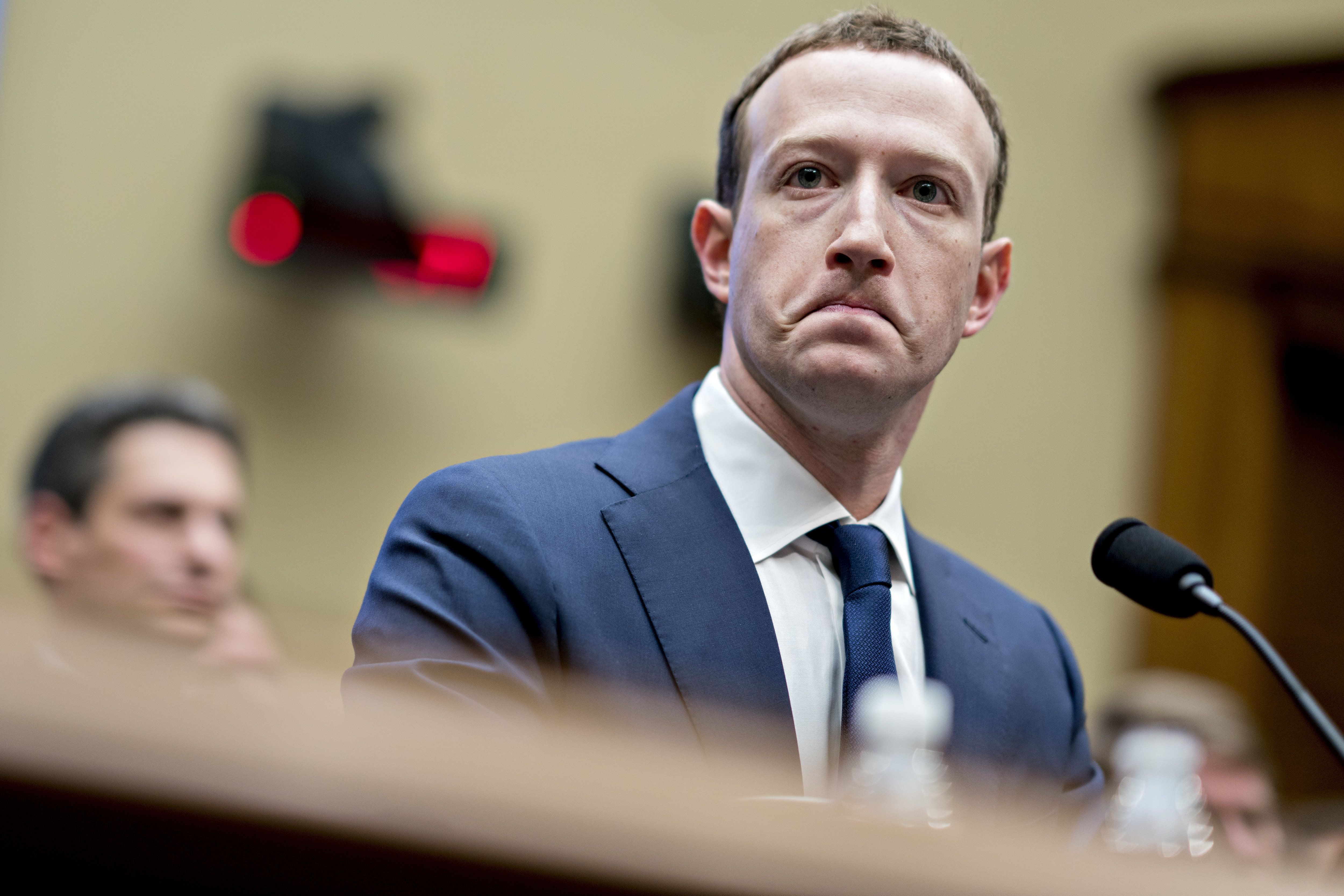 Bloomberg Best of the Year 2018: Mark Zuckerberg, chief executive officer and founder of Facebook Inc., listens during a House Energy and Commerce Committee hearing in Washington, D.C., U.S., on Wednesday, April 11, 2018. Photographer: Andrew Harrer/Bloomberg via Getty Images