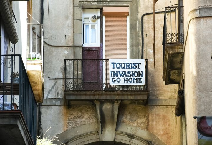 A banner in Barcelona, Spain. The city has seen protests over hyper-tourism.