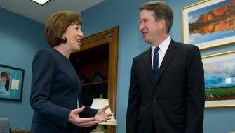 Sen. Susan Collins, R-Maine, speaks with Supreme Court nominee Judge Brett Kavanaugh at her office, before a private meeting on Capitol Hill in Washington on Tuesday, Aug. 21, 2018. (AP Photo/Jose Luis Magana)