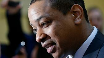 Virginia Lt. Gov. Justin Fairfax speaks to the media in the rotunda at the Capitol in Richmond, Va., Monday, Feb. 4, 2019. The Ivy League-educated lawyer and presiding officer in Virginia's Senate would become the state's second African-American governor should Ralph Northam resign over a racist photo on his 1984 medical school yearbook page. (AP Photo/Steve Helber)