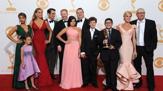 "From left, Sarah Hyland, Aubrey Anderson-Emmons (front) Sofia Vergara, Ty Burrell, Jesse Tyler Ferguson, Ariel Winter, Nolan Gould, Eric Streetstone, Rico Rodriguez, Julie Bowen and Ed O'Neill of ""Modern Family"" pose backstage after winning the award for outstanding comedy series at the 65th Primetime Emmy Awards at Nokia Theatre on Sunday Sept. 22, 2013, in Los Angeles.  (Photo by Scott Kirkland/Invision for Academy of Television Arts & Sciences/AP Images)"