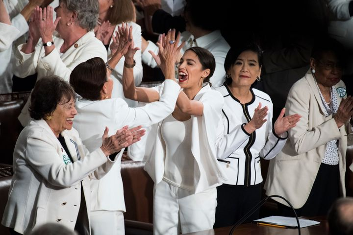 Rep. Alexandria Ocasio-Cortez (D-N.Y.) sharing a moment with her colleagues at a different point in the night.