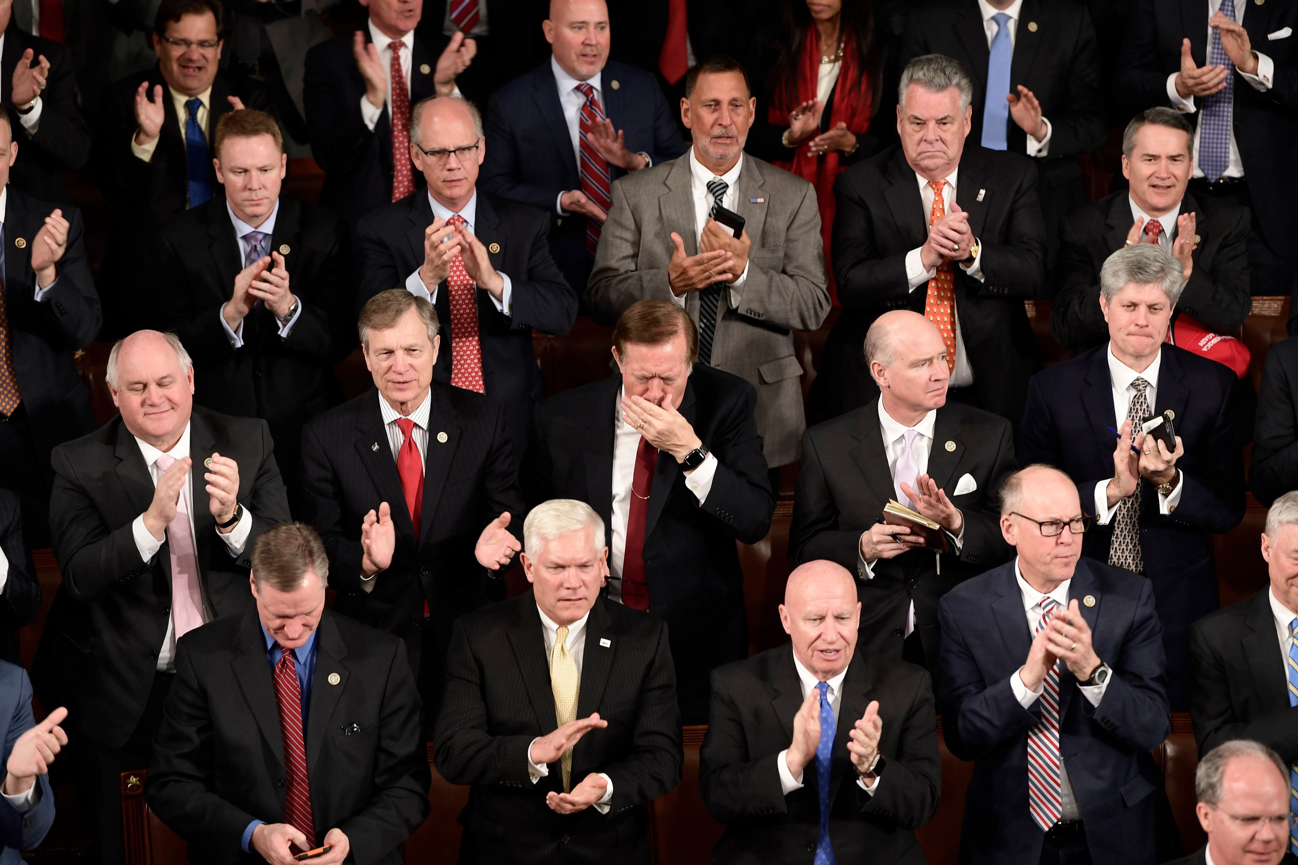 Republican members of Congress clap as US President Donald Trump delivers the State of the Union address at the US Capitol in Washington, DC, on January 30, 2018.  / AFP PHOTO / Brendan Smialowski        (Photo credit should read BRENDAN SMIALOWSKI/AFP/Getty Images)