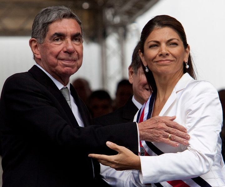 Costa Rica's then-President Laura Chinchilla, right, seen embracing outgoing president Oscar Arias on May 8, 2010.